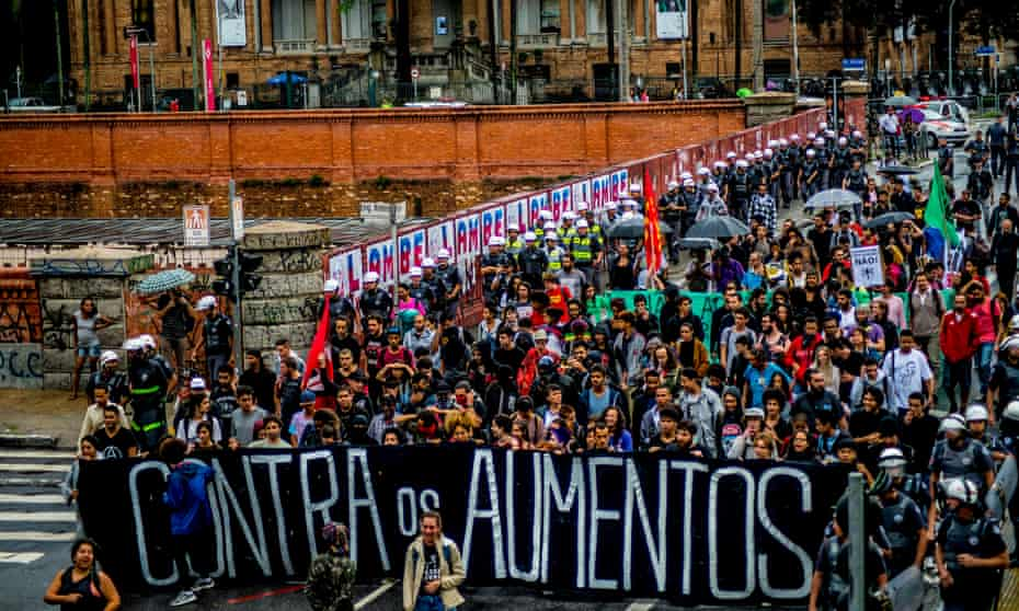 Protesters march through the streets of São Paulo last month in response to the raise in transport fares.