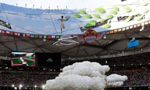 A performer is hoisted into the air during the opening ceremony of the World Athletics Championships at the Bird's Nest stadium in Beijing.