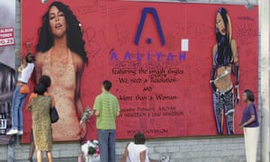 Fans of Aaliyah write messages on a Sunset Boulevard billboard after her death in a plane crash in 2001.