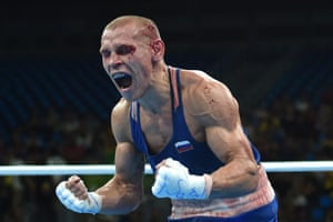 Blood-covered Vladimir Nikitin of Russia reacts after being awarded the bantamweight bout against Ireland's Michael John Conlan.
