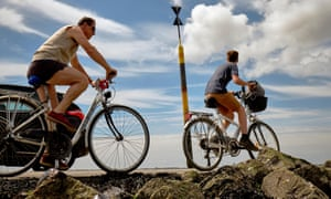 Cyclists on  the Passage du Gois, uncovered for just a few hours at low tide.