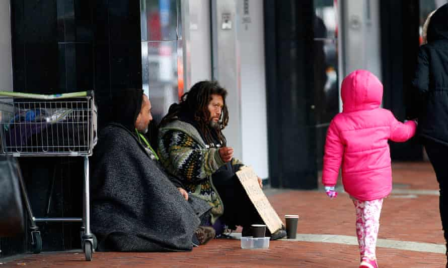 Homeless people beg for money in the Auckland CBD.