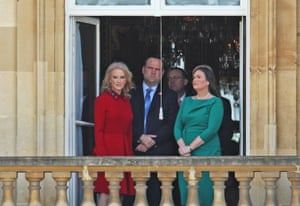 Sarah Sanders (right), Donald Trump's press secretary, and Kellyanne Conway (left), political advisor, watch on from a window during the Ceremonial Welcome