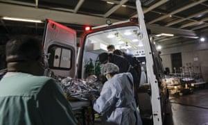 A man suspected of having Covid-19 is transferred by a mobile emergency care service to Hospital das Clínicas, São Paulo, Brazil.