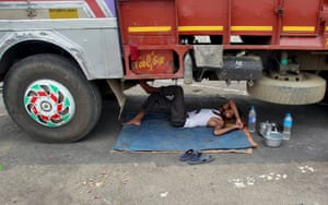 Snoozing in the shade under a truck in Agartala, in the state of Tripura, north-east India