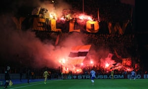 Dynamo Dresden fans show their support in a DFB Cup match against Hertha Berlin last October – the club could still play behind closed doors later this month.