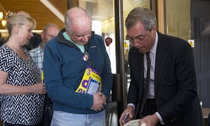 UKIP leader Nigel Farage signs books after a public meeting in Sandwich, Kent.