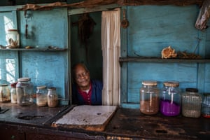 Phoeswa, a South African traditional medicine pharmacist, waits for customers in the Alexandra township of Johannesburg, on 6 April.