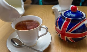 Cup of tea from a Union Jack painted teapot.