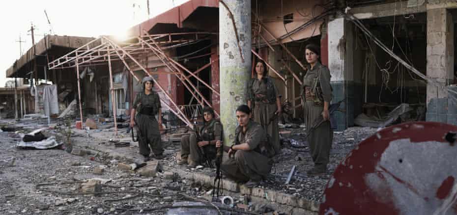 Fighters of YJA-Star (the Free Women's unit) from left to right: Evîndar Cûdî, Shevjîn Herekol, Hêja Botan, Nûdem, and Berçem Penaber.