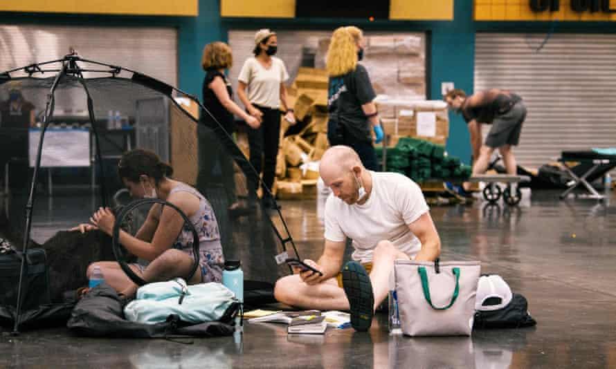 People resting at a cooling station during a heatwave in Portland, Oregon, June 2021
