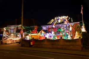 Christmas lights on display at a house in Hayes Lane, Bromley, London. The house is well known in the local area for its festive displays and every year raises money for charity with a collection box in the front garden