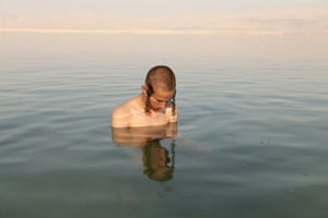 Baruch by Laura Pannack, 3rd Place Winner, Series Baruch. This image shows Baruch confronting himself in the oily Dead Sea. He is two men, one will replace the other.At the age of 16, Baruch chose to leave his Orthodox Jewish community and study. The dramatic and challenging decision forced him to question his identity and future. Einstein says the important thing is to not stop questioning. Curiosity has its own reason for existing. This project explores how we choose our paths in life and questions how much control we have to change who we will become.