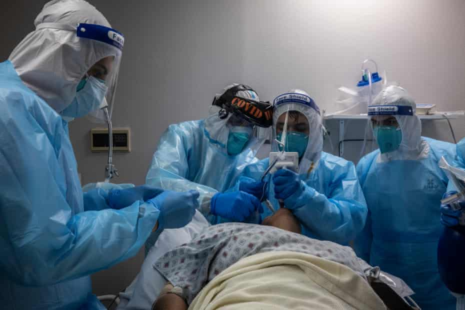 Healthcare workers treat a patient suffering from Covid-19 in Houston, Texas.