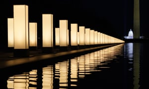 Lights surround the Lincoln Memorial Reflecting Pool, placed as a memorial to COVID-19 victims .