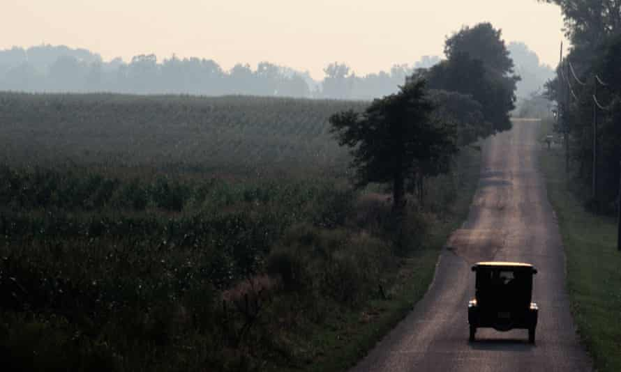 A 1925 Model T driving down an old strip of the National Road, Indiana.