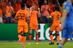 Wout Weghorst celebrates after doubling the Netherlands' lead.