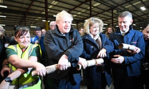 Boris Johnson pulling Christmas crackers with staff during a visit to IG Design Group in Hengoed.