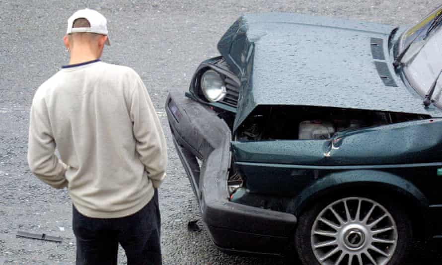 A young man looking at damage to his VW Golf GTI
