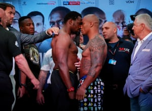 Dean Whyte looks on from the left of brother Dillian before a recent weigh-in.