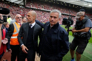 Pep Guardiola is greeted by Jose Mourinho