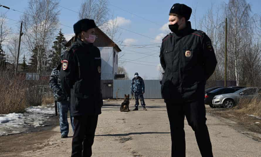 Russian police officers guard the entrance to the penal colony where Alexei Navalny is being held, ahead of a planned protest in his support on Tuesday.