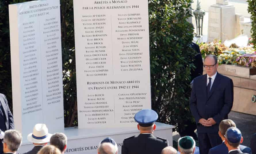 Prince Albert II, right, pays his respects after unveiling a monument to Jews deported from Monaco during second world war, as part of a larger effort to shed light on a troubling chapter in the country''s history.