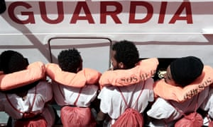 Rescued migrants on an Italian coastguard boat following their rescue from the NGO rescue ship Aquarius.