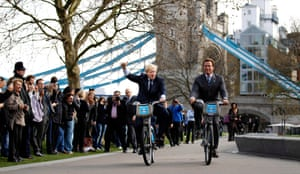 London mayor, Boris Johnson, and Arnold Schwarzenegger, former governor of California, pose on hire-scheme bicycles. The pair met to exchange ideas on green technology.