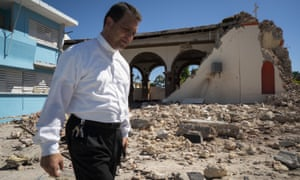 A priest inspects damage to the Parroquia Inmaculada Concepción church after a 6.4 earthquake hit just south of the island on Tuesday.