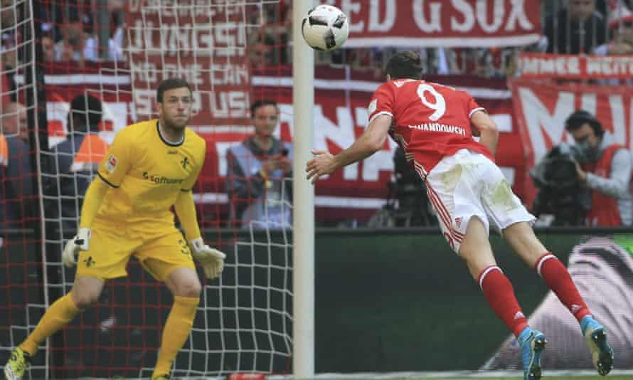 Bayern Munich's Robert Lewandowski guides a header towards goal in the the Bundesliga match with Darmstadt.