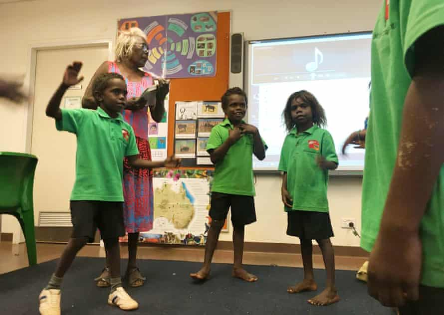Indigenous children do the hokey pokey during a Wubuy language class at the Numbulwar school in eastern Arnhem Land.