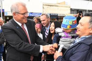 Scott Morrison (left) with the minister for immigration, citizenship and multicultural affairs, David Coleman (centre) meets with residents and business owners during a walk through Hurstville in Sydney.