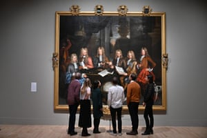 London, UK: Gallery workers pose with The Whig Junto by the British artist John James Baker during a press viewing of the British Baroque: Power and Illusion exhibition at the Tate Britain. The exhibition focuses on baroque culture in Britain and runs from 4 February to 19 April
