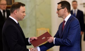 Poland's president, Andrzej Duda (left), designates Mateusz Morawiecki as the new prime minister in the presidential palace in Warsaw