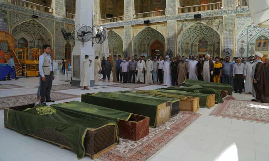 A funeral ceremony on 13 July for victims of the fire at the Al-Hussein hospital, Nasireyah