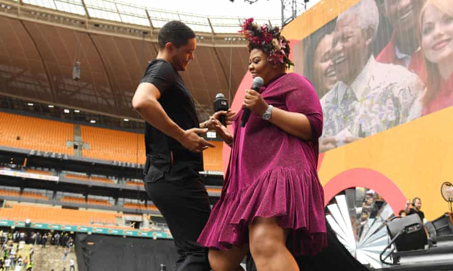 Trevor Noah on stage with Anele Mdoda