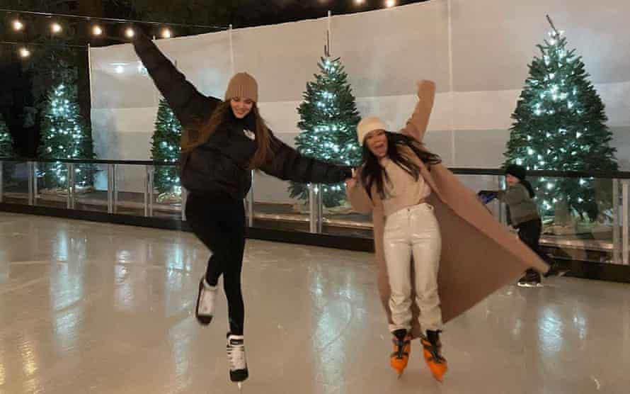 Kendall Jenner, ice skating with sister Kourtney Kardashian, wearing The North Face brown puffer.
