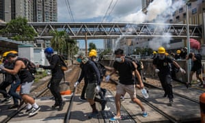 Riot police fire teargas toward protestors outside Tin Shui Wai police station on 5 August.