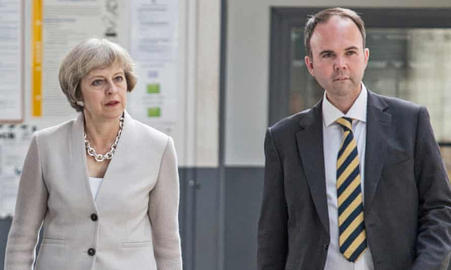 Theresa May walks walks with ex-housing minister, Gavin Barwell.