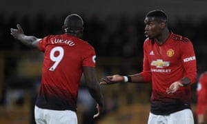 Paul Pogba argues with Romelu Lukaku during the first half.