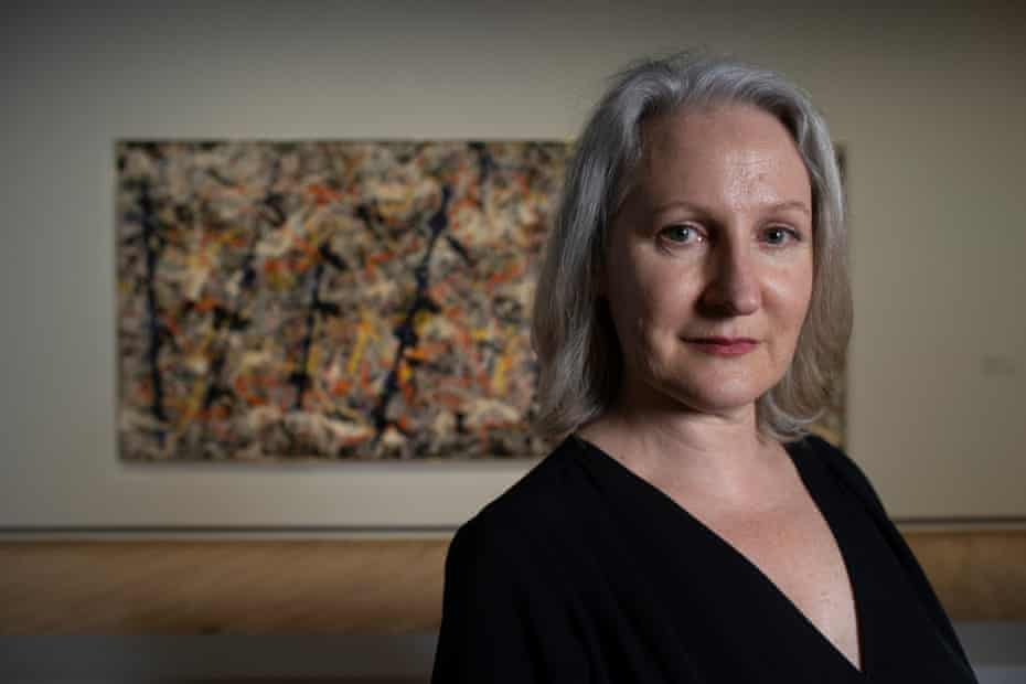 Angela O'Keeffe in front of Blue Poles