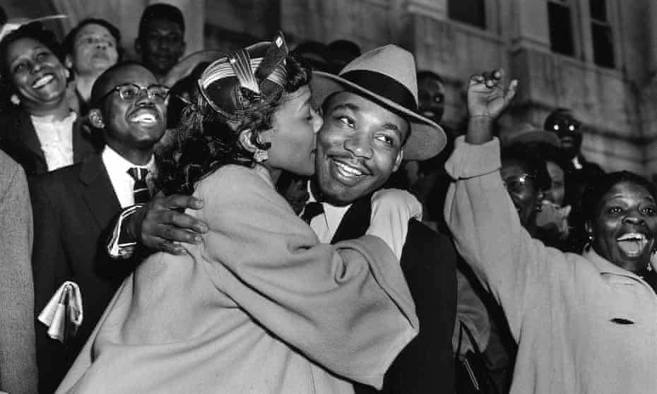 The Rev Martin Luther King Jr is welcomed with a kiss by his wife Coretta after leaving court in Montgomery, Alabama, in 1956.