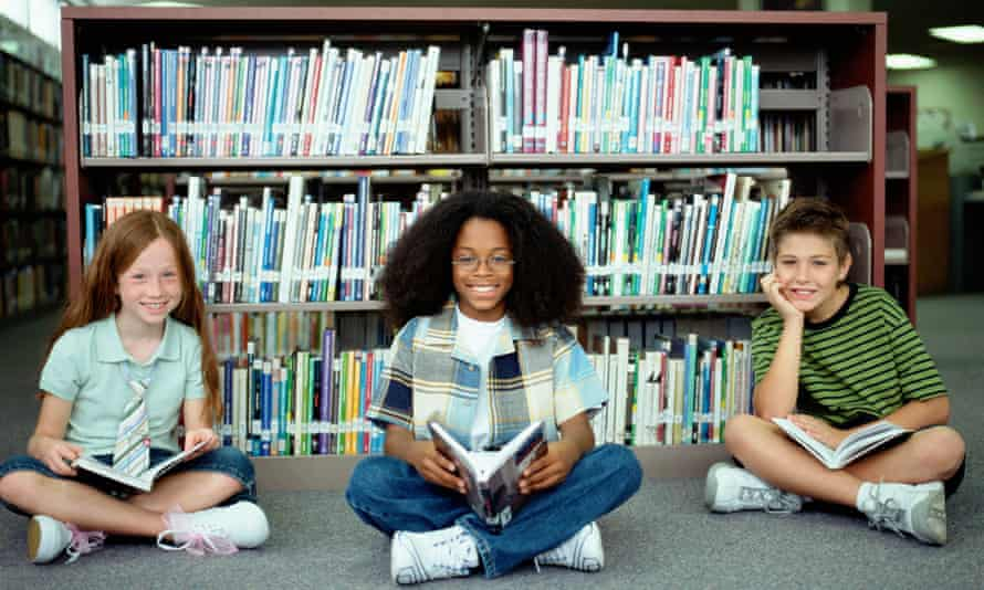 Children sitting in library