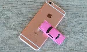 The iPhone 6S and a baby pink Cadillac toy