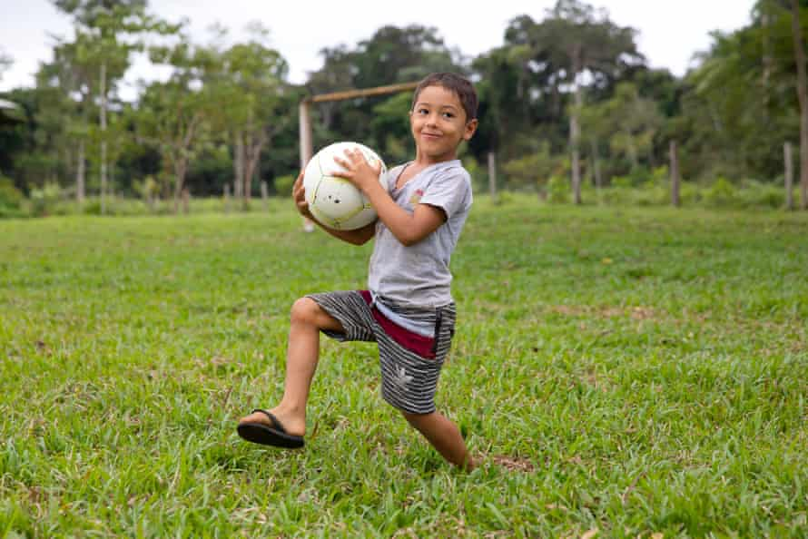 Six-year-old Maiso Aquino plays with a football.