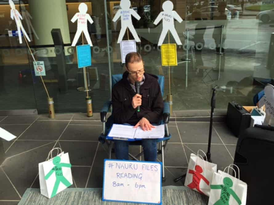 A member of the 'Love Makes A Way' Christian movement reading from the Nauru files outside the department of immigration in Melbourne to highlight abuses against people in detention.