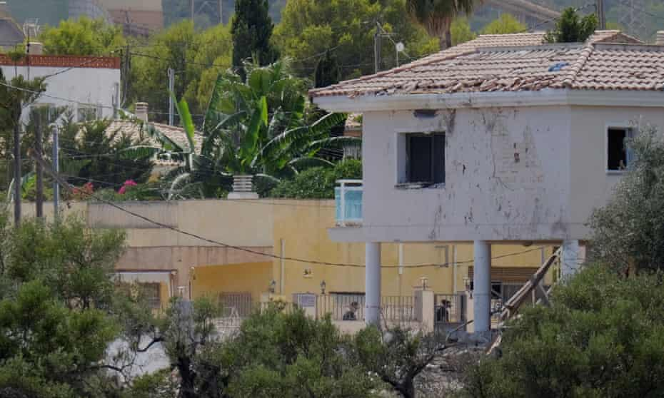 A building with shattered windows next to the site of the bomb factory blast in Alcanar, Spain