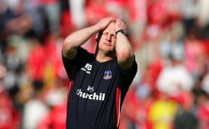 Crystal Palace manager Iain Dowie reacts after his team's relegation against Charlton Athletic