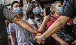 People wear face masks in Manila